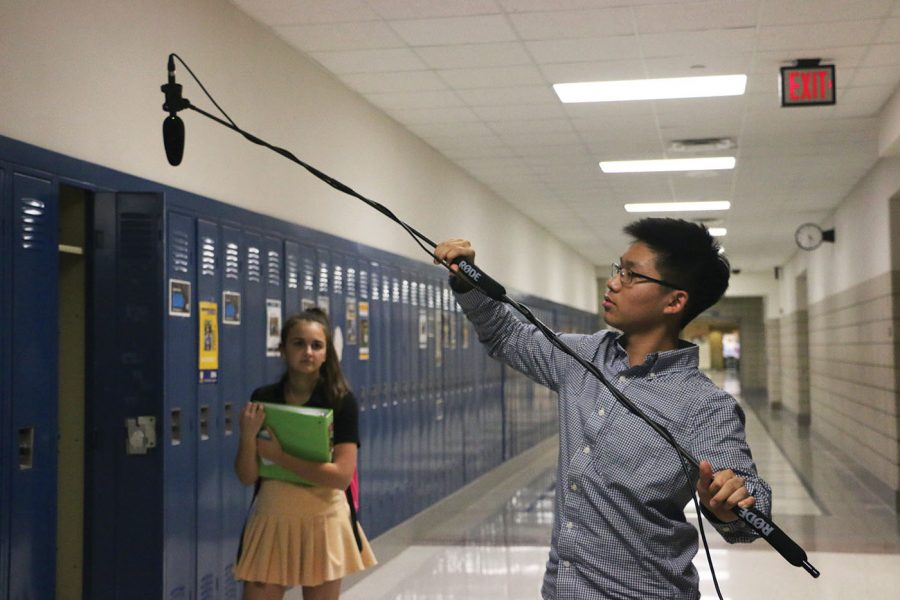 Director and sophomore Sam Kim moves the mic as junior Natalia Trevino Amaro sets up. Trevino Amaro plays Ashley in Kim's movie.