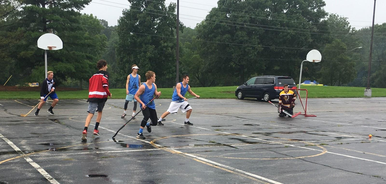 Senior Nathan Zweig is seen playing with other members of GISHL in the parking lot next to the stadium. GISHL had many scrimmages and will continue their season.