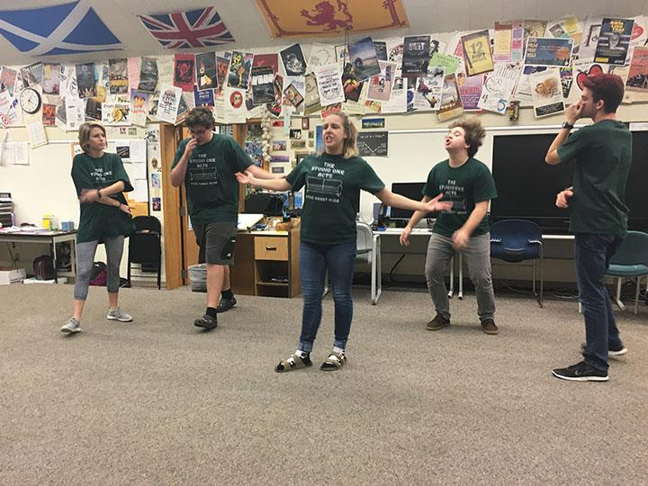 """Jessica """"Jessie"""" Ballard, ComedySportz member and senior plays an improv game with her teammates. The team was developing their comedy skills by attempting to create comical rhymes to make the audience laugh."""