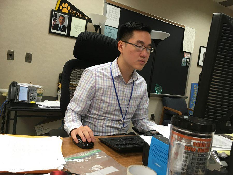 Director of orchestras Thomas Chen prepares the program for the orchestra concert. Chen said the concert will feature several well-known pieces, including excerpts from the Nutcracker Suite.