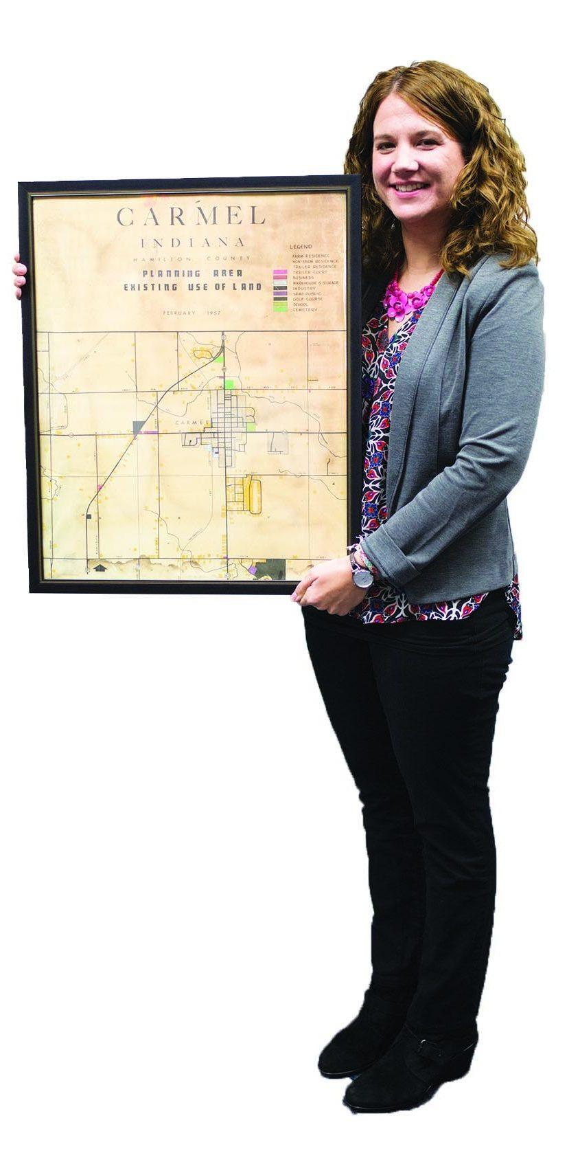 SPECIAL STATE: U.S. History teacher Allison Hargrove stands with her classroom Carmel map. She said she stayed in Indiana as an adult because it felt like home.