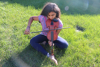 "Another String To Her Bow:  Freshman Abirami ""Abi"" Meyyappan plays the carnatic violin"