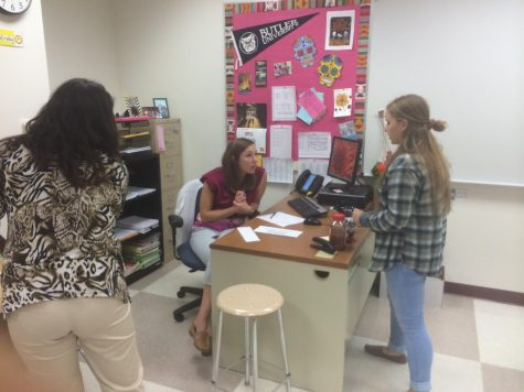"Sara Martin, Spanish Club sponsor and teacher, discusses upcoming plans with Anna Boucher, Spanish Club president and senior, during their last meeting on Nov. 16. Martin said, ""For our last meeting, we watched travel vlog videos about el Dia de los Muertes, which happened in November. It's about a travel vlogger that really got to the heart of the day of the dead: it's not just a party; it's a way for them to connect to the people they lost, and so it's a happy."""