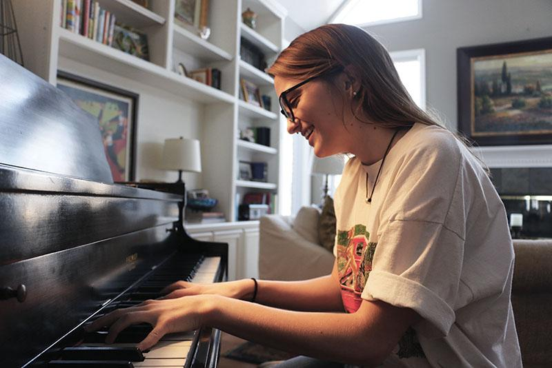 Junior Anna Fagin plays the piano. Fagin distributes her music primarily through SoundCloud, a popular music streaming website.