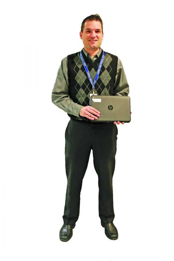 TECH-NICALLY SPEAKING: Ryan Ringenberg, technological coordinator at CHS, stands with a Chromebook. Ringenberg said the district is working on new policies and best practices for the integrated technology in the classroom.