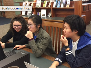 Junior Catherine Yuan (far right), alongside sophomore Selin Oh (center) and junior Kiki Koniaris (far left) work on a project together at the Carmel Clay Public Library. According to Yuan, most of the people who attended top 3 percent last school year were involved in a wide array of activities and this portrays the emphasis on both school and extracurriculars from both the PTO and CHS.
