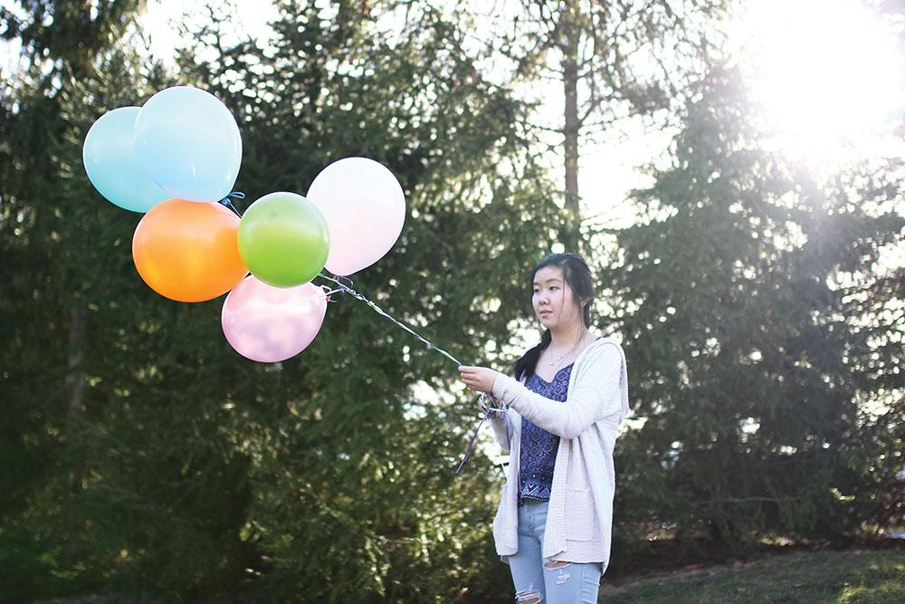 REMEMBERING THE PAST: Junior Joanna Zhang reminisces her past experiences at the circus with balloons reminding her of her childhood trip. Zhang said while there is some awareness of animal cruelty in the entertainment industry, there is not enough.