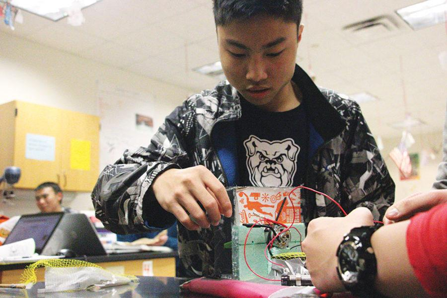 Chang checks the motor to his hovercraft. He said this is for the upcoming state competition for Science Olympiad.