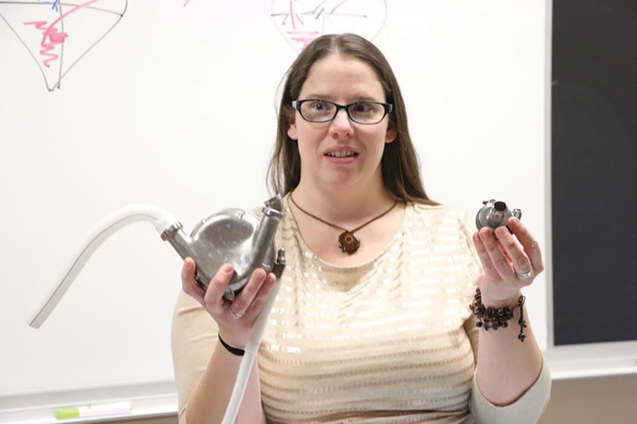 EDUCATED IN EDUCATION: Erin Odya, human anatomy and physiology teacher, explains how the left ventricular assist device (LVAD) works. Odya showed the devices to her class for their cardiovascular unit. Odya said she disapproved of DeVos as Secretary of Education; however, she also said CHS will maintain its tradition of excellence in education through DeVos's term.