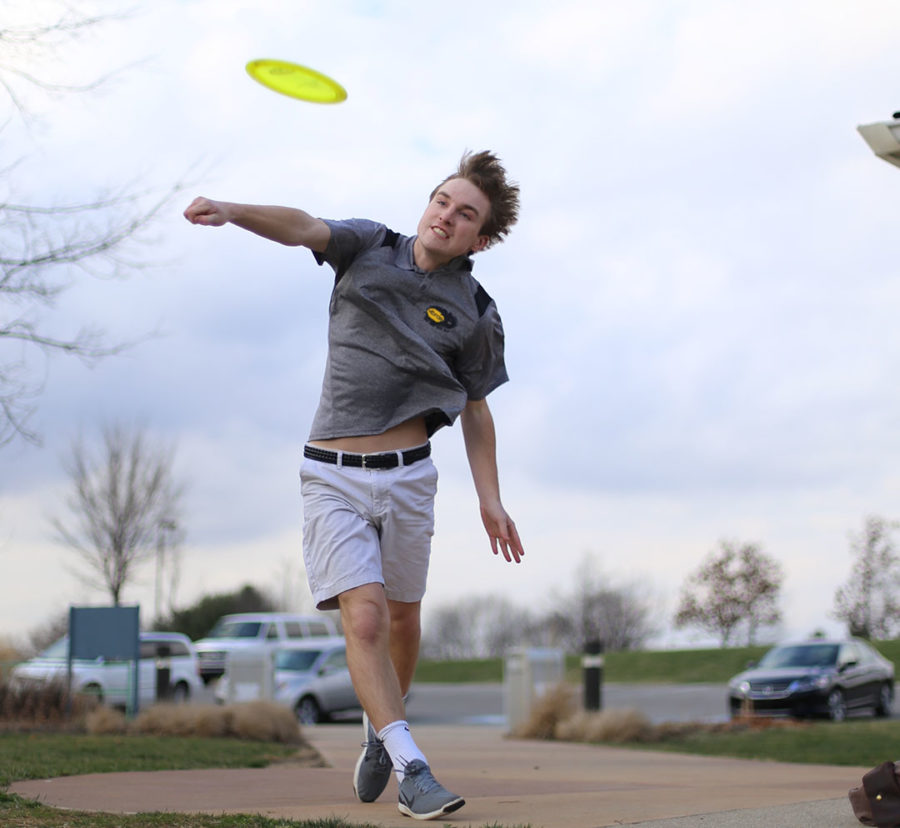 HIGH FLYER: Jackson Holforty, disc golf player and senior, throws a disc after school at Northview Church. Holforty is highly ranked among disc golfers.