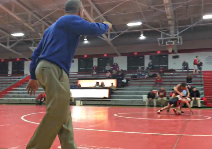 Head+Coach+Ed+Pendoski+on+the+sideline+intently+watches+a+match+at+Center+Grove+mid+season.+The+Greyhounds+defeated+Center+Grove+43-10.%0A