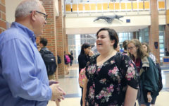PRINCIPLE OF PRINCIPALS:  Principal John Williams talks to senior Sarah Biette. Student Body President Mike Pitz said it saddens him to see him go, but he appreciates the time and leadership Williams provided.