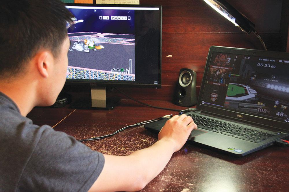 Senior Brendan Yap watches a live stream video game with Twitch.tv. Yap said he uses Twitch because he thinks it is informative and entertaining.