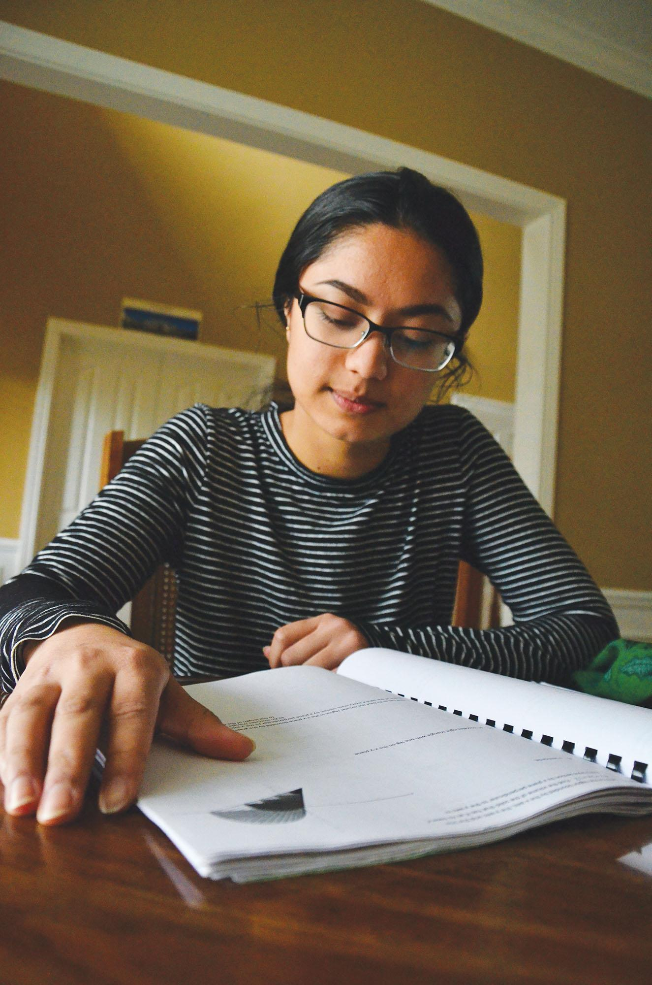Sophomore Seema Dhungana reads her notes out loud to study for a test. Dhungana said reading the material and saying it at the same time helps her remember key points.