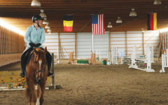 Junior Evie Heffern trains with her horse, Casmir, in preparation for a competition. Heffern has been riding horses for six years.