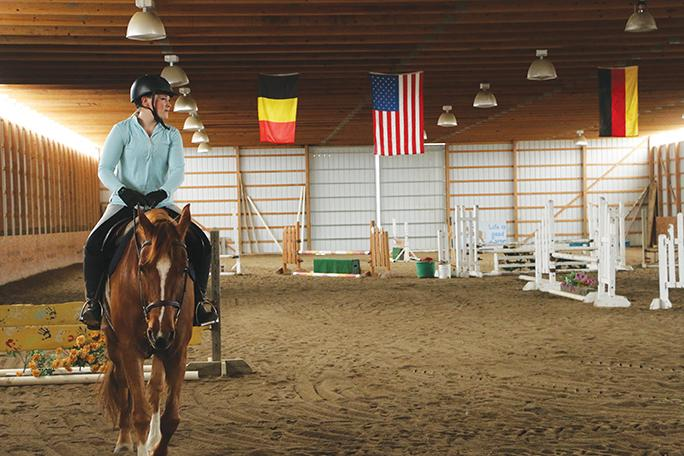 Junior+Evie+Heffern+trains+with+her+horse%2C+Casmir%2C+in+preparation+for+a+competition.+Heffern+has+been+riding+horses+for+six+years.