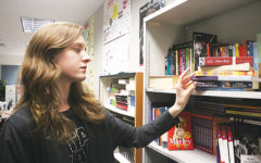 Junior Genevieve Zircher finds a book to read during class. Zircher said she identifies herself as a democratic socialist; however, although the U.S. has some democratic socialist policies, other people consider democratic socialism  as a radical thought.