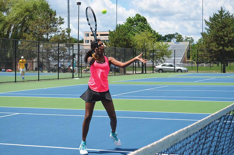SUMMER+WORK%3A+Anjali+Natarajan%2C+women%E2%80%99s+tennis+player+and+freshman%2C+practices+tennis+at+Zionsville+High+School+over+the+summer.+She+went+to+Sycamore+School+before+transferring+to+Carmel.+%0AJess+Canaley+%7C+Photo