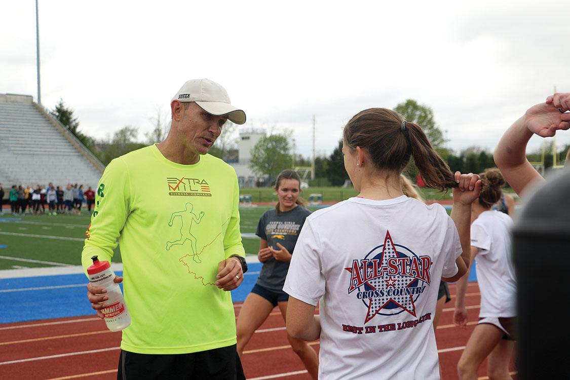 Real+Talk%3A+%0AHead+Coach+Andy+Dalton+discusses+recovery+and+training+with+senior+and+varsity+runner+Corrine+Miller.+Miller+believes+Dalton+will+bring+many+effective+ideas+to+the+program.