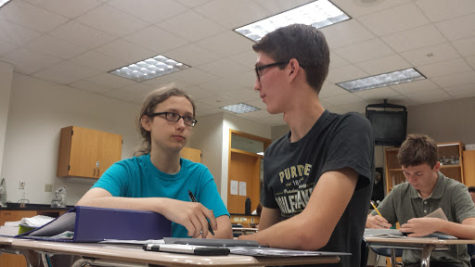 Club members Ben Ring and Kian Robinson discuss plans for the White River cleanup during their SRT class.
