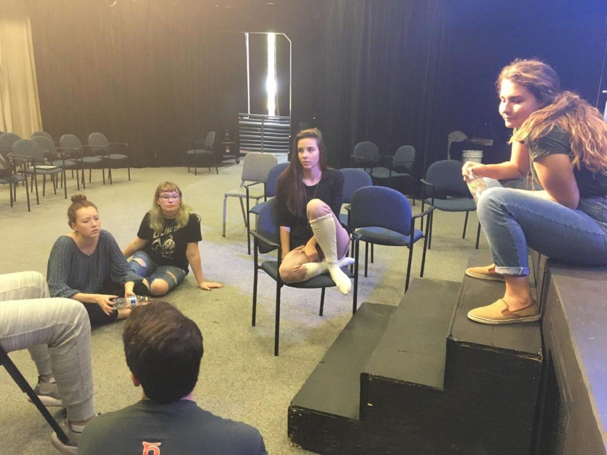 Charlotte Seidensticker, student director for Studio One Acts and senior, meets with the cast of her production to discuss the setup of the stage. Seidensticker said she appreciates the fact that student directors are able to design each aspect of their stages.