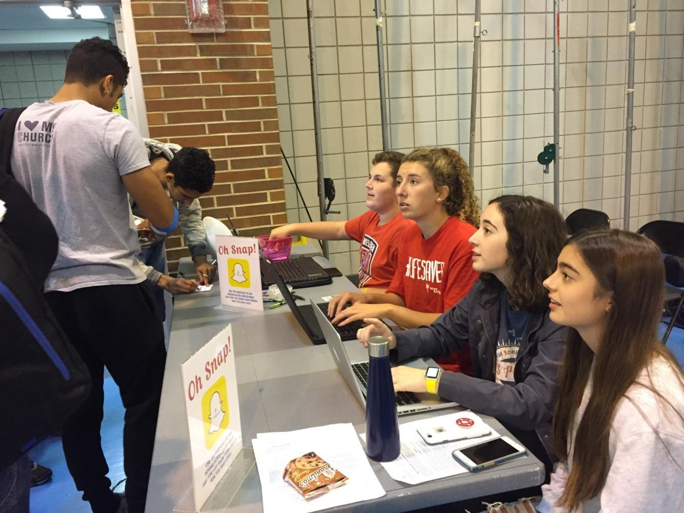 Senators work at the Blood Drive last Friday. Now, Senators are working on Homecoming and Custodial Appreciation Week, as well as Care to Share and other activities for the future.