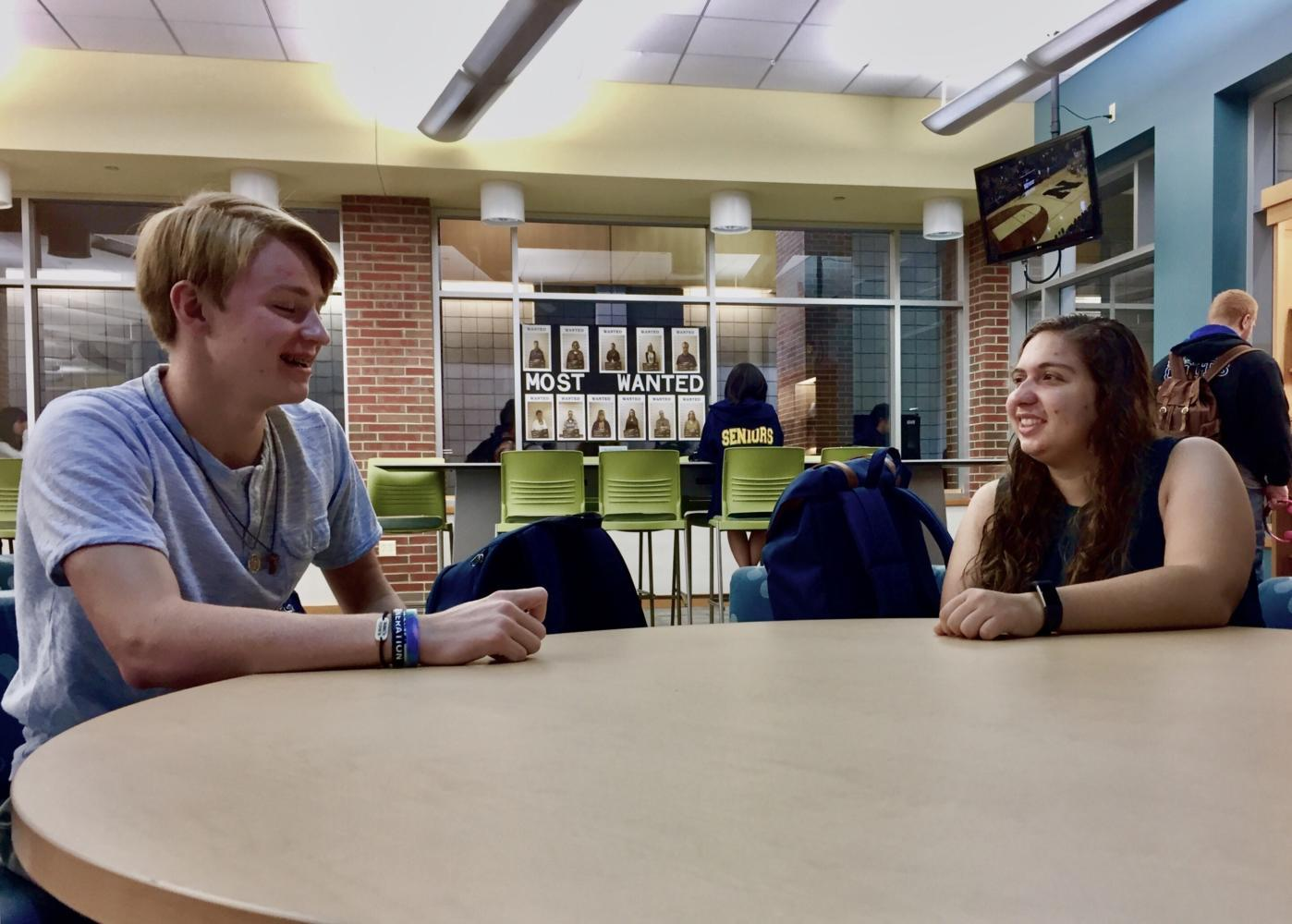 Sophia Tragesser, Teens for Life president and senior, and Michael Greener, Teens for Life treasurer and junior, meet in the library to discuss future club plans. The club has not found a sponsor yet, and the members have scheduled meeting with possible sponsors throughout the week. ​