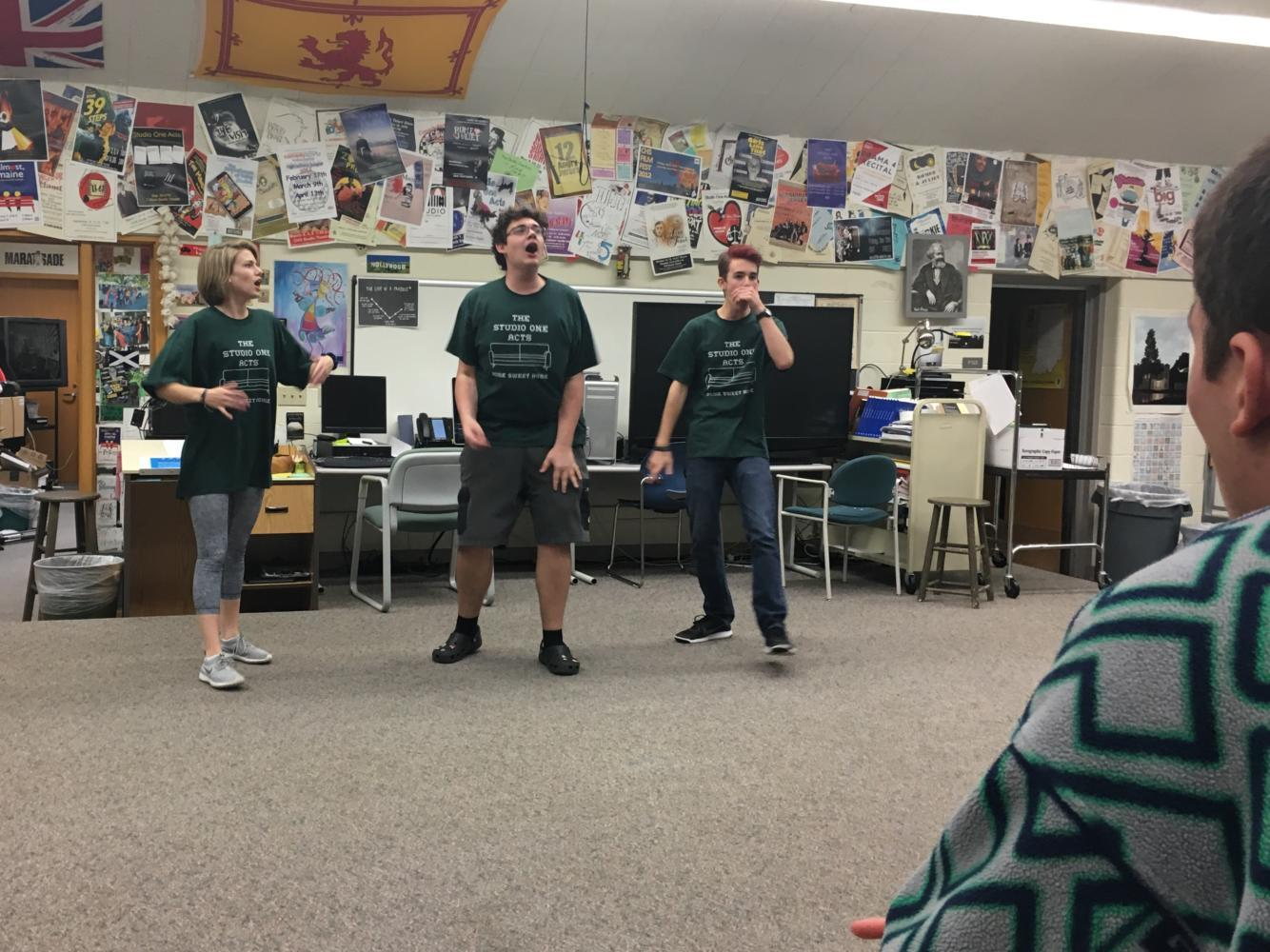 ComedySportz members Georgia Simmons, Chuck Burton and Jake Greene compete against each other during an improv game. Through this game, they prepared for their upcoming matches in the spring.