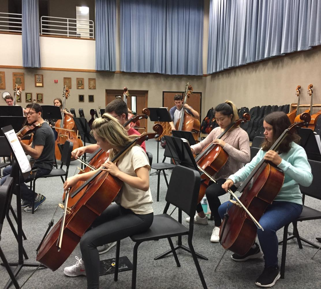 """The cello section of Symphony Orchestra practices their new music. Angelike """"Kiki"""" Koniaris said, """"Cello section is the best section."""""""