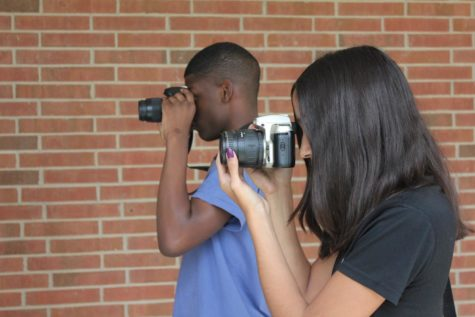 Through the Lens: With photos becoming progressively more prevalent in  everyday life, CHS students and staff reflect on their purpose