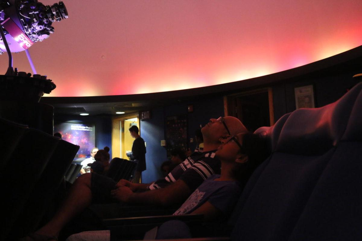 Attendees+at+the+Planetarium+Show+on+Sept.+28+watch+the+show.+Turner+said+viewers+were+able+to+learn+about+identifying+various+constellations+and+stars+among+a+variety+of+other+interesting+information.+