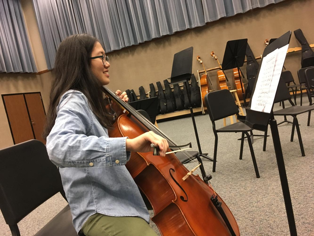 Selin Oh, Camerata cellist and junior, practices her cello in the orchestra room during SRT as a part of small-group rehearsals. Oh said she is excited to be playing a variety of tunes from different operas with the Symphony orchestra.