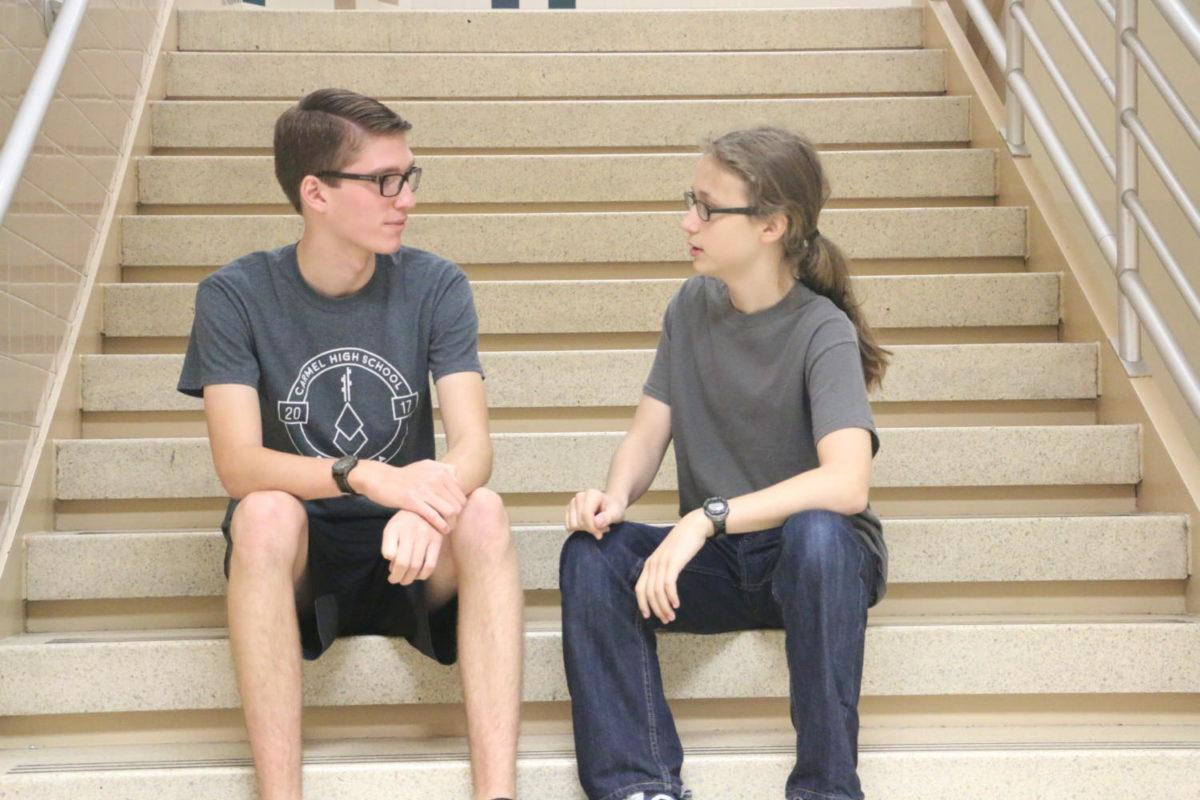 Club members Kian Robinson and Ben Ring discuss the schedule to bring in their guest speaker.
