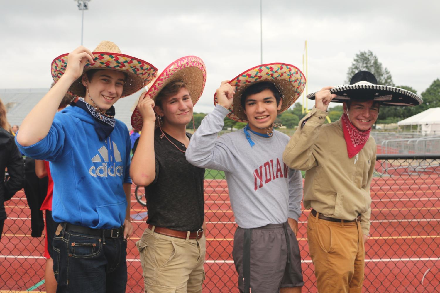 (Left to right) Noah Steiner, Oscar Cronin, Luke Belcher and Lawrence Arceneux pose for the camera on September 13th, at the Carmel High School Stadium. This team of sophomores has been training hard and are prepared for the trike race preliminaries. The team, The Three Amigos, concluded that they are all very excited for the thrill of competing in the trike race.