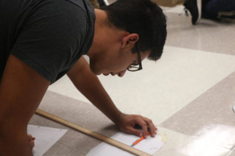 """Senior Nickolas """"Nick"""" Gemelas completes a lab during his B4 Physics C class. Gemelas, on the subject of age gaps in classes, said he believed having a wide range of ages in a class could prove beneficial to students."""