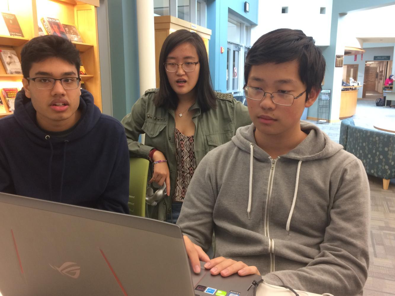 Seniors Aakash Roy, Catherine Qing  and Kevin Chen (left to right) use Canvas to complete their homework during SRT. Chen said although more could be done to improve the integration of Canvas, he prefers it over previous platorms, such as Edmodo and Moodle.