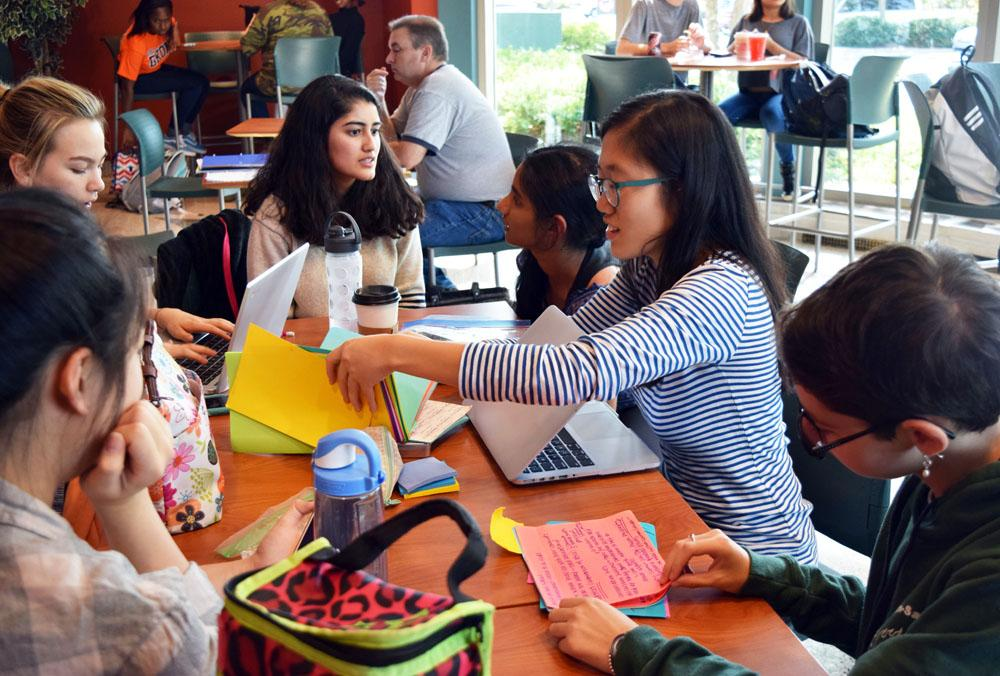 Members of the group Let's Talk continue their discussion on how to create a better environment at CHS for open discussion. Selin Oh, founder of the group Let's Talk and junior, said she believes it is important to increase the conversation.