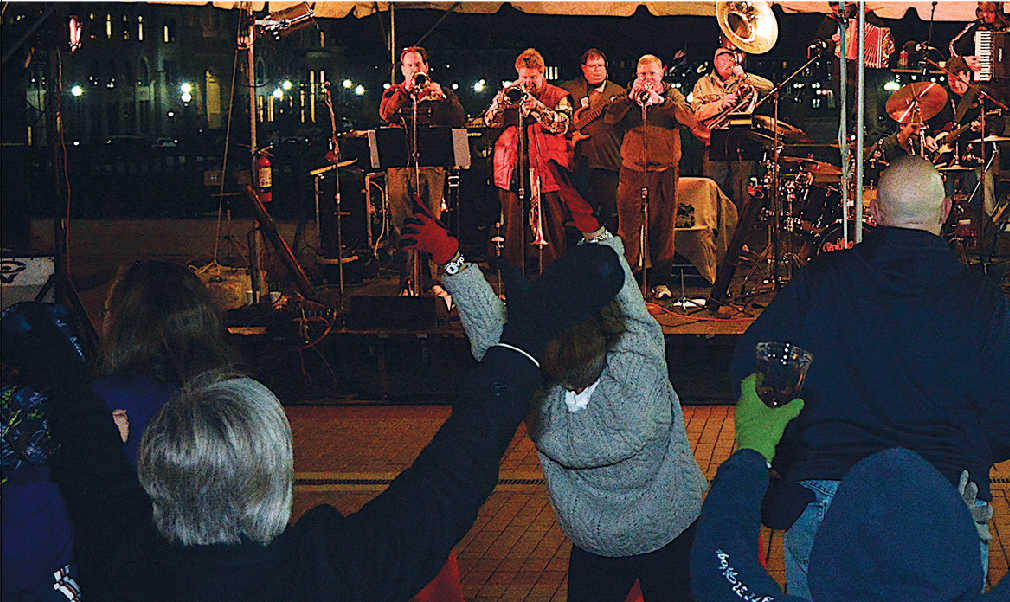 OKTOBER FUN:  OktoberFest attendees cheer for the band performing onstage. This year, the polka band Polka Boys will be performing in Carmel for the celebration.