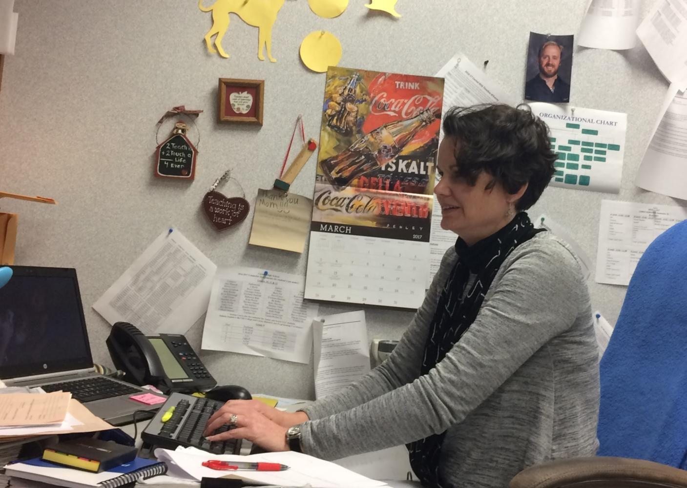 Math+department+chair+Jacinda+Sohalski+quietly+works+at+her+desk.+For+the+past+few+weeks%2C+she+has+been+working+actively+to+rework+the+curriculum+around+the+new+textbooks.+