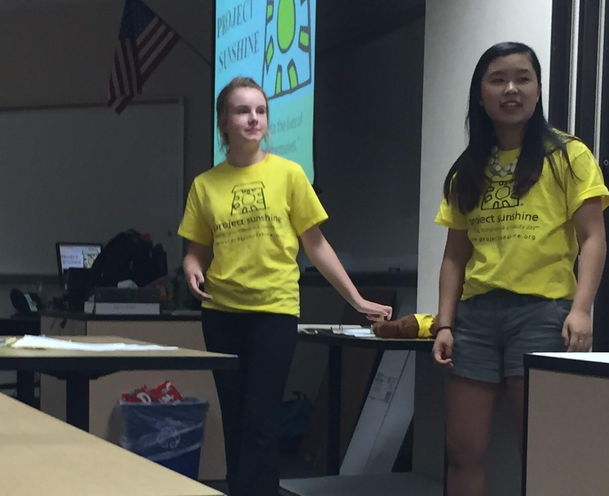 Hannah Bromm and Nyssa Qiao, Project Sunshine co-presidents and seniors inform members on what the club will consist of.