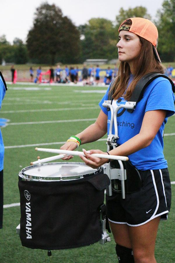 TCP Senior Syd Holtzapple practice after school with the marching band. Holtzapple said her extracurriculars often conflict with her schedule and make it difficult to become accustomed to her new symposium schedule.