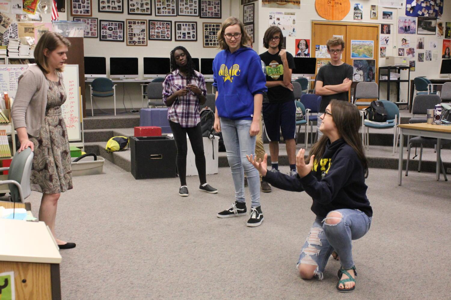 Allie Crawford, ComedySportz member and junior plays an improv game. In this game, team members took turn acting out various activities to improve their physicality.
