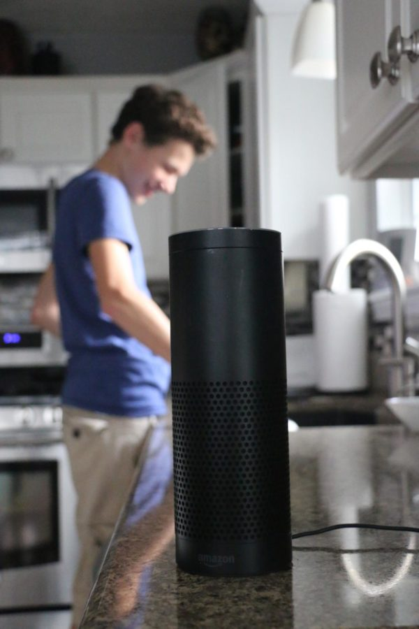 Sophomore+Nathan+Willman+does+household+chores+with+Alexa+by+his+side.+Willman+said+he+believes+the+new+technology+provides+a+new+frontier+of+technology.+