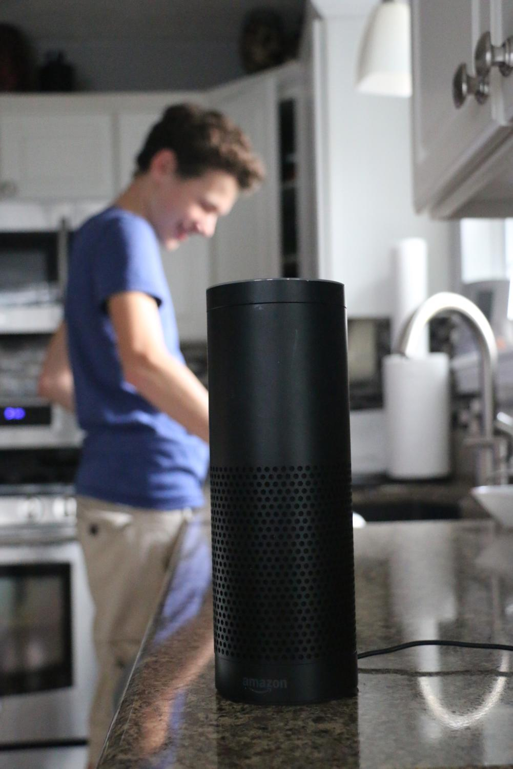 Sophomore Nathan Willman does household chores with Alexa by his side. Willman said he believes the new technology provides a new frontier of technology.