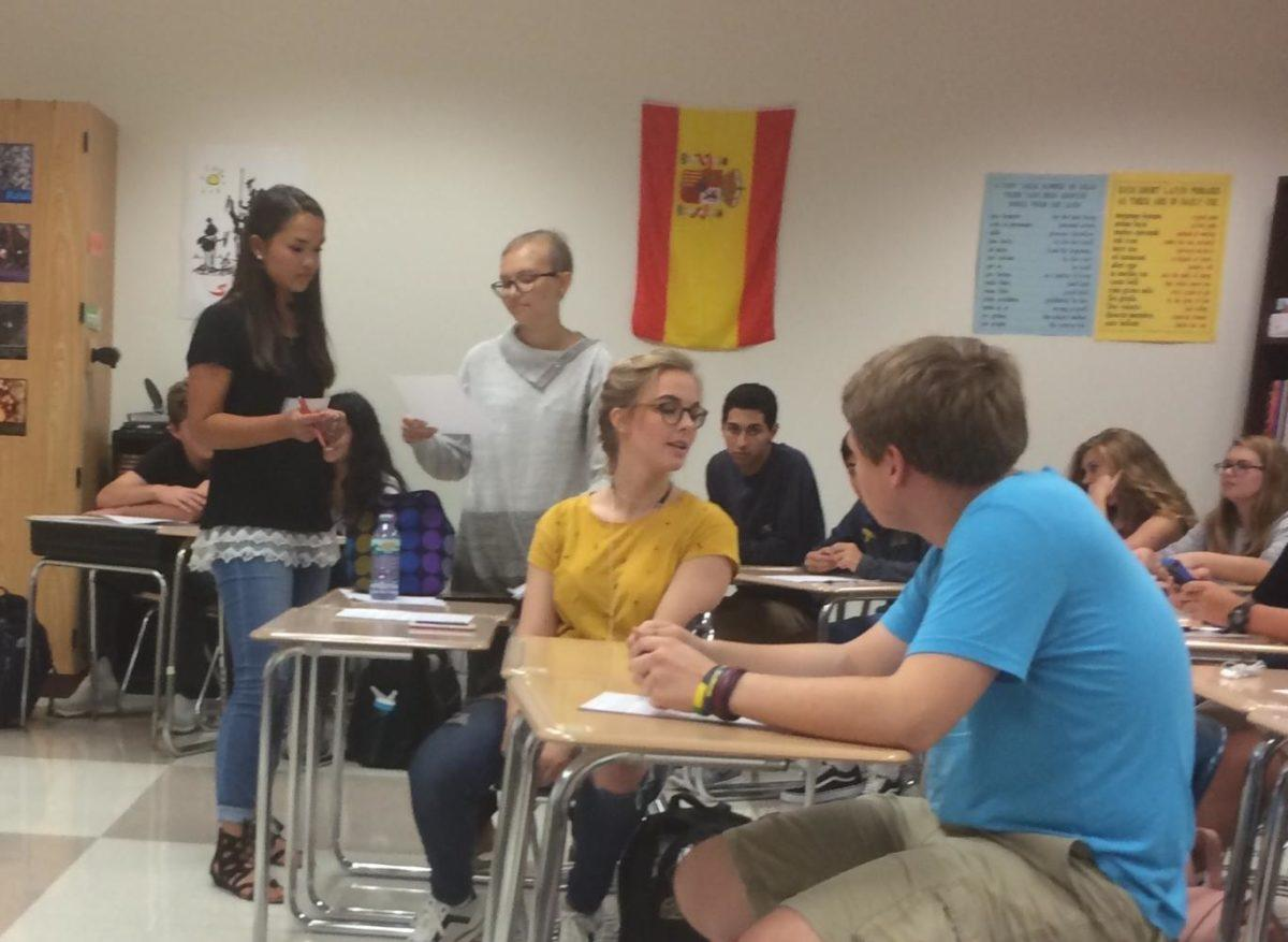 In Spanish Club's call-out meeting on Sept. 20, Kate Adinaya, Spanish Club president and senior, announces upcoming plans for a field trip to Carniceria Guanajuato. Adinaya said that permission slip forms can be turned in outside of B201.