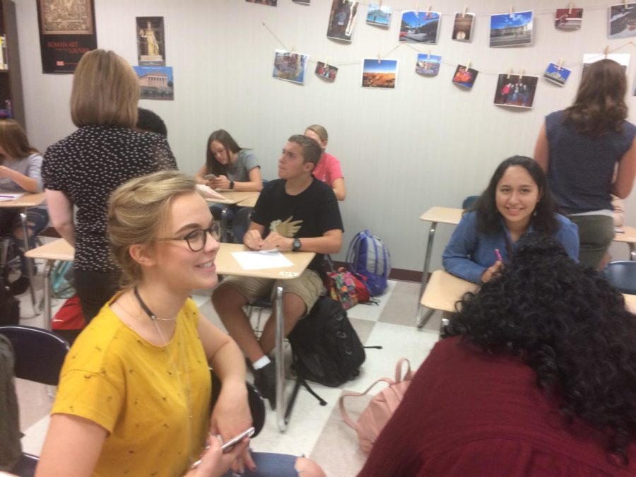 """Spanish Club members gather before leaving for their first field trip to Carniceria Guanajuato on Oct. 18. Kate Adinaya, Spanish Club president and senior, said """"We got to speak to the waiters in Spanish, enjoy some delicious, authentic food, and learn more about the other members in the club."""""""