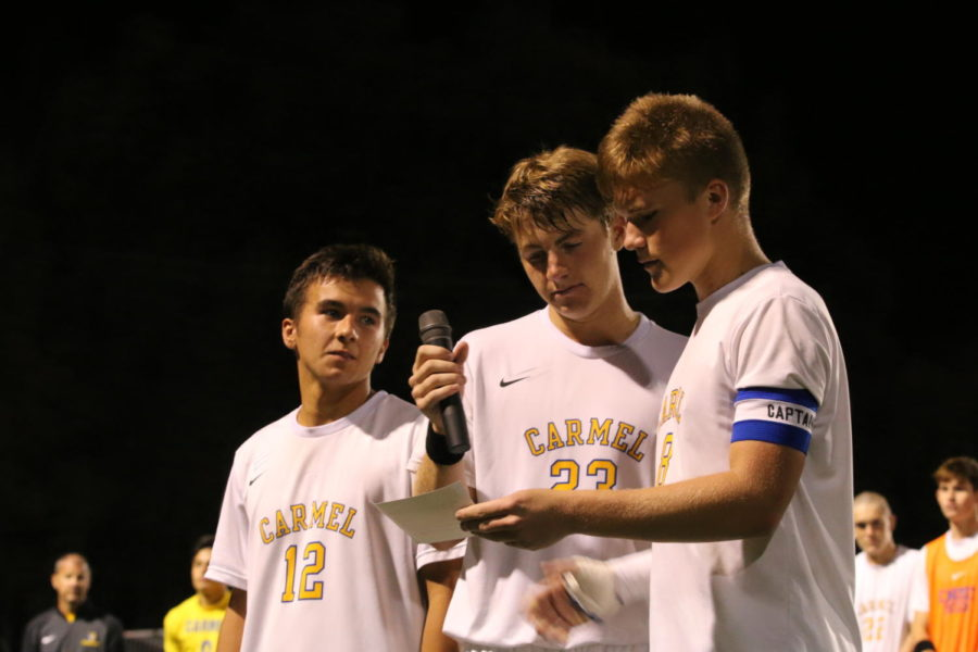 Jack Mueller, captain of the men's soccer team and senior, prepares to give a speech on Make Good Decisions Night. The tshirts helped raise money for charity.