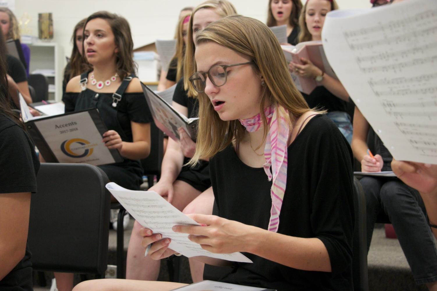 Senior Anna Fagin reads music for her Cabaret performance. Fagin auditioned with Accents Alyssa Easton and Cory Steele for a spot in the show on Oct. 21.