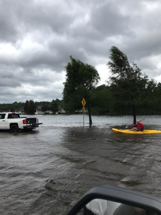 After the storm, sophomore Calvin Reeder's family in Florida tries to drive down the street that is flooded with water. Hurricane Maria devastated Florida and Reeder's family there. Submitted by Calvin Reeder.