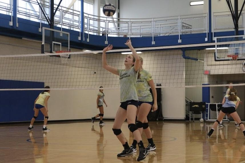 Senior Kailey Akins sets the ball during practice. The team was doing a drill that focused on keeping the ball controlled when passing it to another player.